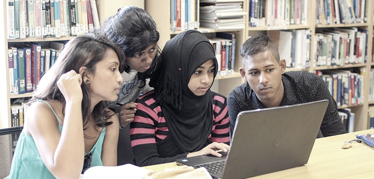 Students interacting in the library
